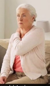 old lady with aching shoulder
